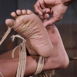 Lisa Tiffian drooling around rope gag.