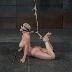 Darling writhes and screams on floor in rope bondage