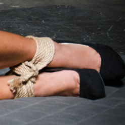 Maxine X struggles on floor in rope bondage