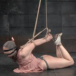Endza languishing on floor in rope bondage
