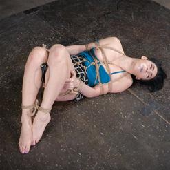Aria Alexander bound in rope bondage, school girl skirt