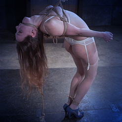 Sierra Cirque crying on floor in chest harness rope