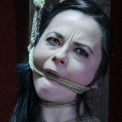 Ivy Addams in rope bondage with painful nipple clamps