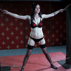 Ivy Addams legs tied together by ankle rope bondage