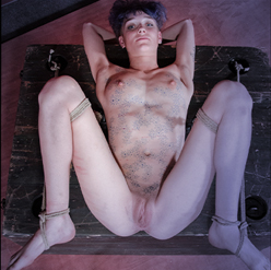 Billy Nyx panties pulled aside to show shaved pussy