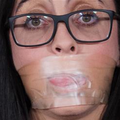 Roxanne Rae in tape gag