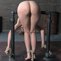 Zoey Lane on back, legs spread, in extreme rope bondage