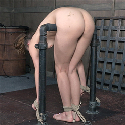 Zoey Lane bent in half with nipple clamp bondage