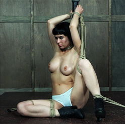 Olive Glass struggles against crotch rope