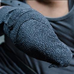 Alina West hand in vet wrap bondage