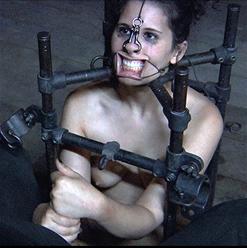 Marina's metal-shackled feet
