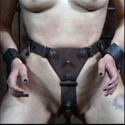 Marina in hood, legs spread, wearing chastity belt