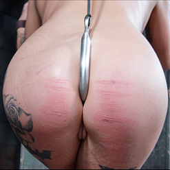Kat Valentien shows off ass hook and cane marks