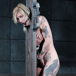 Kleio Valentien stripped naked, exposed, trying to cover up