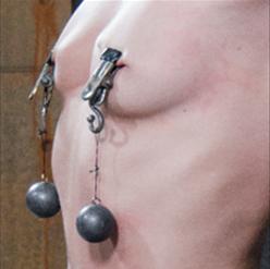 Hands behind back with shackles in metal bondage