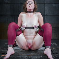 Mary Jane has weights hanging from pussy clamps