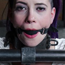 Freya French screams in pain in metal bondage