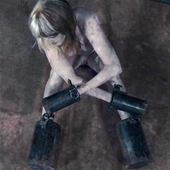 Terrified April Rain drools on her own tits in bondage