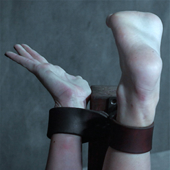 Sasha Heart's feet held helpless leather strap bondage