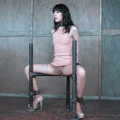 Charlotte Sartre gagged in belt and metal bondage