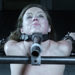 Maddy O'Reily in belt bondage with her ass stuck out