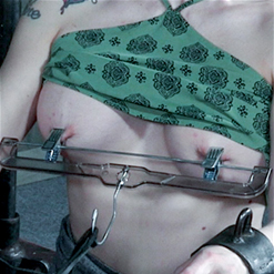Leya Falcon's nipples clamped by clothes hanger