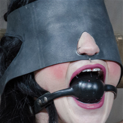 Lydia Black in black ball gag and latex blindfold
