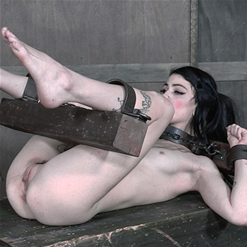 Lydia Black nipple peaks through cut dress and rope bondage