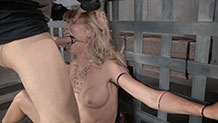 A gagged and bound Simone Sonay gets her face fucked by dick