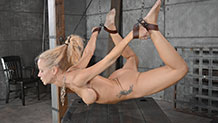 Stunning Simone Sonay suspended in a strict hogtie