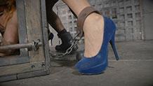 Simone Sonay's blue velvet heels and leg shackles