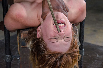 Kay Kardia tormented with cane up nose in metal bondage
