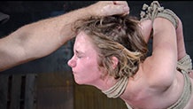 Mercy West in slave training position