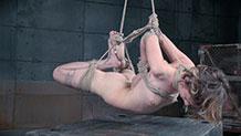Mercy West crying in rope bondage neck rope