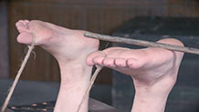 Mercy West feet caned in foot to nipple rope bondage