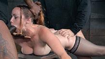 Bound Bella Rossi deepthroats hard cock