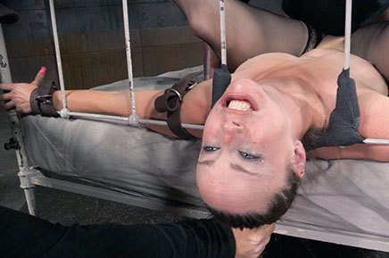 Beautiful Bella Rossi suffers in belt bed bondage