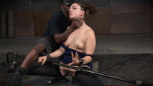 Bound and shackled Endza deepthroats the dick