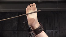 Harley Ace foot shackled, caned
