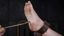Harley Ace's shackled foot is piked with sharp sticks