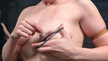 Kel Bowie in arching back clip bondage predicament