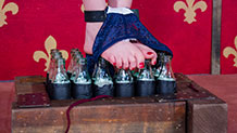 Glass bottles under Sierra Cirque's feet