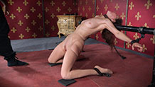 Paintoy Emma arches back in pain on her knees metal bondage
