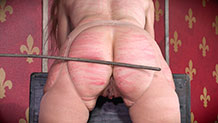 Paintoy Emma bent over, ass caned covered in marks, bruises