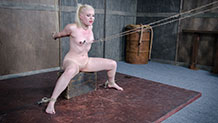 Dresden with legs spread and nipple clamps being pulled