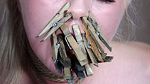 Dresden's tongue and nose covered in clothespins