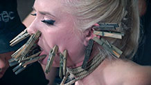 Dresden in a neck rope with clothespins all over her face