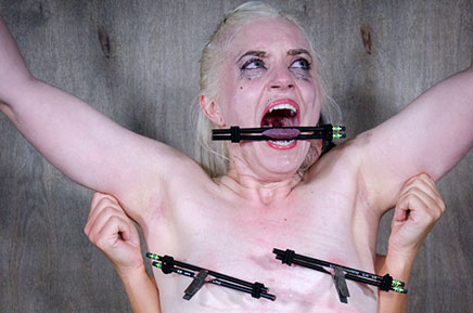 Dresden in nipple and tongue bondage being pinched