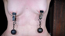 Dresden's tits pulled down by nipple clamps and weights