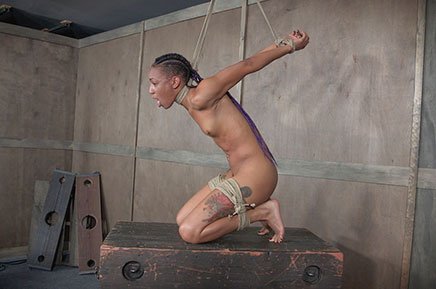 Nikki Darling chokes herself in strappado neck rope combo